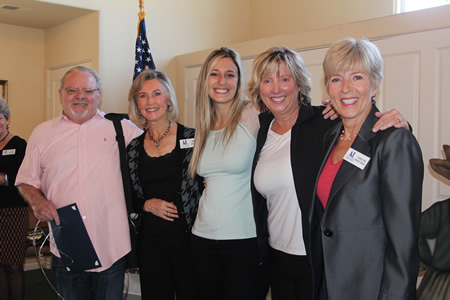Assistance League members Ann Hyde, second from left, and Christine Montonna, far right, honor Stu Saffer and Shaena Stabler as its business persons of the year. With them is Maggi Henrickson, also of Stu News.