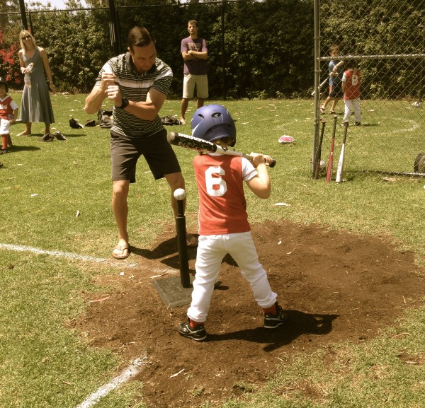 Coach Chris Tyson of Little League's Red Hot Chili Peppers demonstrates proper batting stance during this past Saturday's T-ball game against Team Javiers.