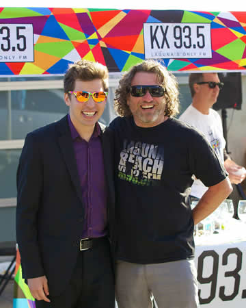 Station manager Tyler Russell, left, with DJ and performer Jason Feddy at last month's gala.