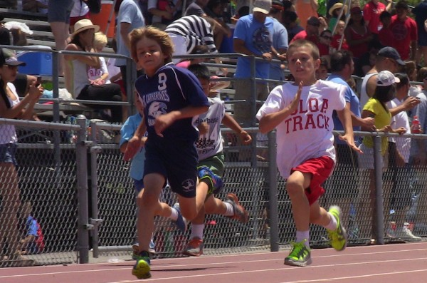 Seahawks Sprint For Gold: Second-grader Pierce Martin finishes first in the 200 meter dash for St. Catherine. The school placed seventh overall in the OC Parochial Athletic League meet with 42 other schools. Photo by: Scott Martin
