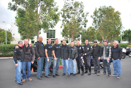 A group of 25 motorcyclists that included Laguna Beach police officers and their friends joined a 500-strong brigade on a 60-mile ride in Los Angeles to honor families of fallen officers last Saturday. Their participation is personal: Officer Jon Coutchie died last September in an on-duty traffic accident. Photo courtesy of Louis Callus