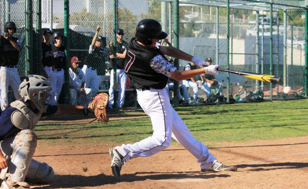 Freshman shortstop Dante Faicchio drills a double down the third baseline to drive in the winning run in the Breakers 4-2 home victory on Tuesday, April 29,  over second place Calvary Chapel. Credit: Robert Campbell