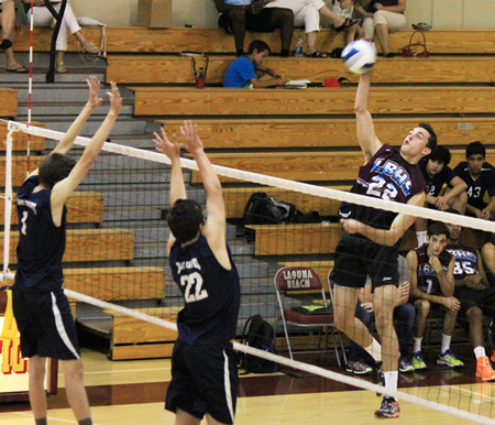 : Jack Burgi goes high for the kill against Calvary Chapel on Tuesday, April 29.  Credit: Robert Campbell