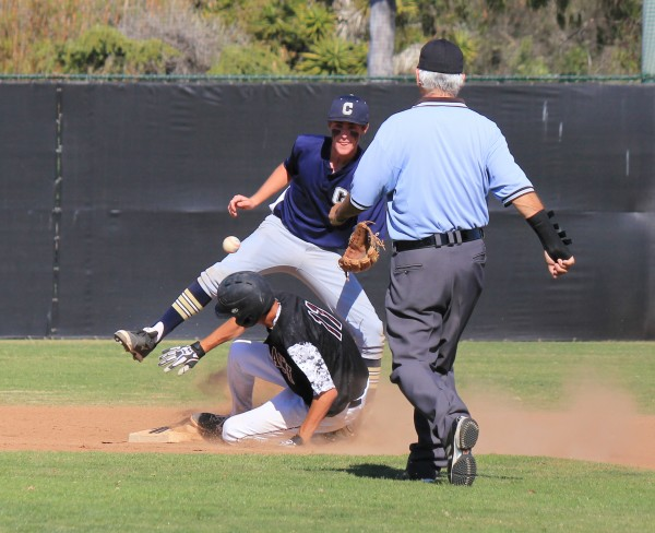 : Senior Preston GrandPre steals his 24th base of the season against Calvary Chapel on Tuesday, April 29.  Credit: Robert Campbell