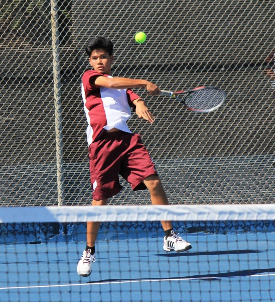 Number two singles player Ryan Gee hits a forehand return on his home court against Calvary Chapel on Tuesday, April 29. Credit: Robert Campbell
