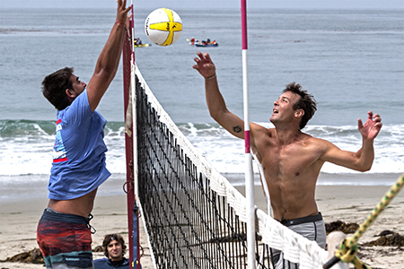 Former Cuban National player Ozz Borges of Hermosa Beach, left, competed in the 59th annual Men's Laguna Open volleyball tournament which last weekend drew some of the largest crowds since its heyday in the 1980s and 90s.