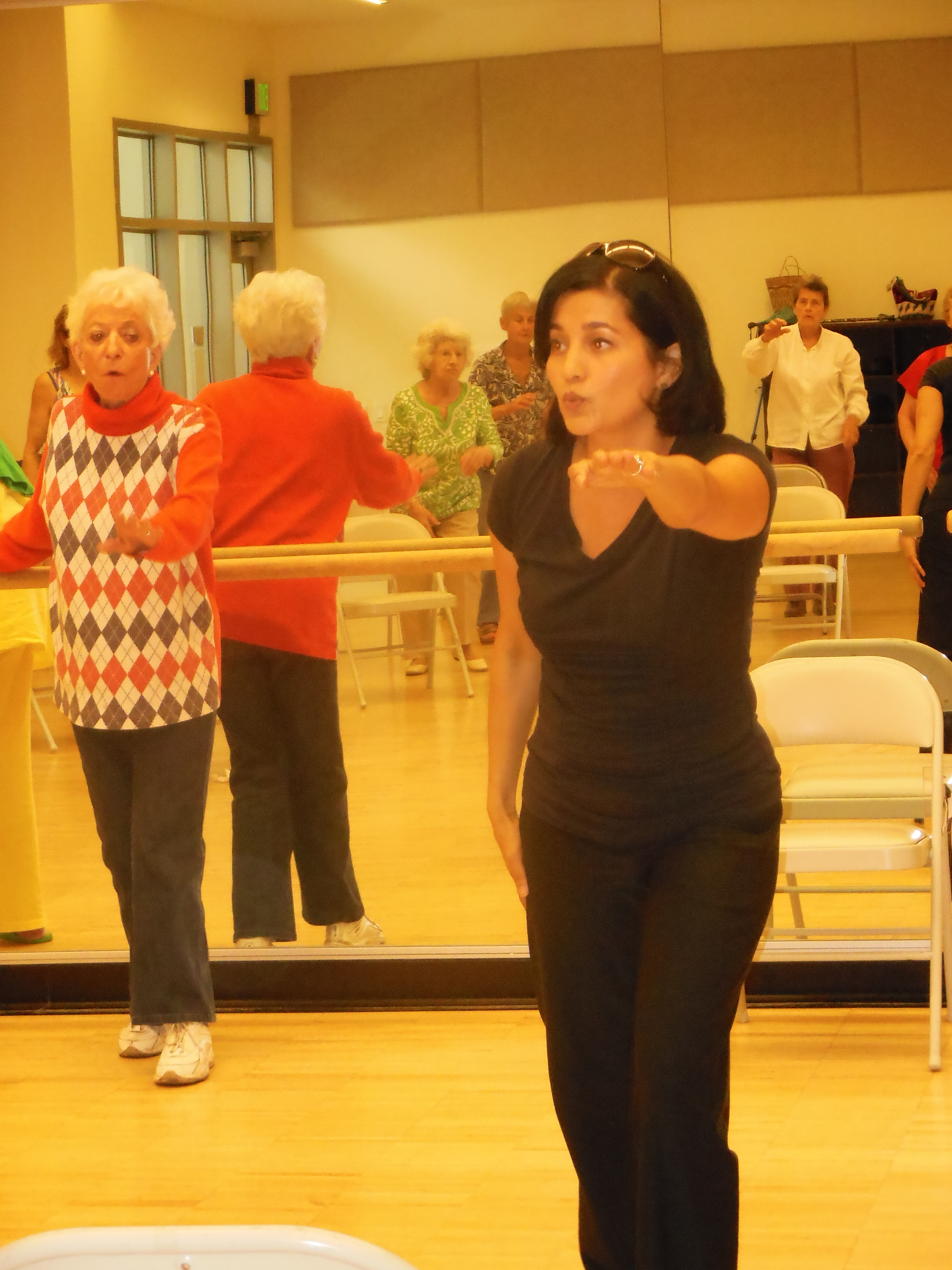 Lola  Gillebaard, left, follows the lead of fall prevention therapist Geeta Singh at the Susi Q class.