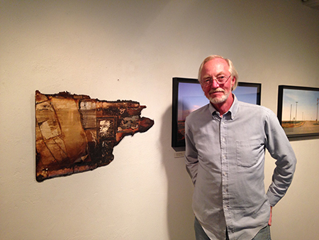 Mark Chamberlain in 2014 at BC Space Gallery with one of the few remnants of the Tell that he created with the late Jerry Burchfield.