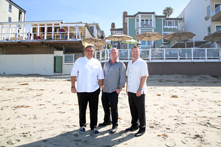 From left, Chef Rainer Schwarz, John Nye and Colby Durnin, of the Sentinel team that manages the Pacific Edge Hotel, remade and rechristened the former Beach House restaurant into the Driftwood Kitchen.