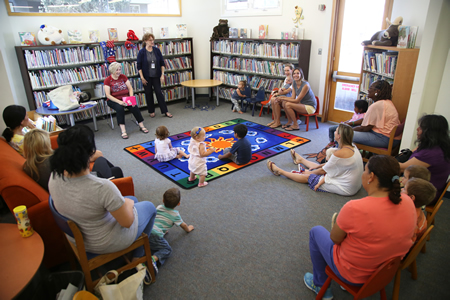 Pam Chesney-Algar, center standing, presides over story time at the library. Photo by Jody Tiongco.