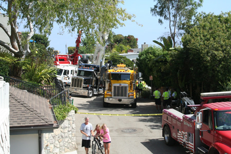 Multiple tow trucks were used to upright the crane.