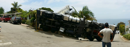 A crane overturned and damaged a house.