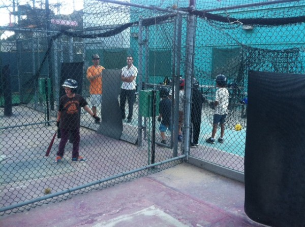 Young baseball players work on their skills in batting cages under new ownership.