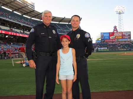 "Laguna Police Chief Paul Workman, left, with Corporal Jason Farris  at Angel Stadium along with SamiG. of Laguna Beach who delivered the ""Play Ball"" announcement."