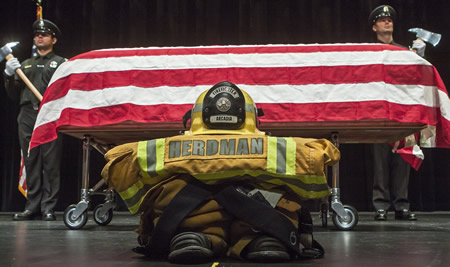 Colleagues remembered former Laguna Beach resident and Arcadia firefighter Mike Herdman for always challenging the status quo during a memorial service Wednesday in Arcadia. His body was discovered Friday, June 27, in the Los Padres National Forest two weeks after he failed to return to a campsite after leaving to fetch his dog.
