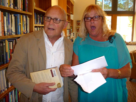 Laguna Food Pantry chair andy Siegenfeld and DeDe Westgaard-Pike are pleasantly shocked at a $12,000 grant, far more than anticipated. Photo by Susan Thomas.