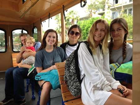 From right, Natalie Johnson, Kalani Fajardo, Allyson White and Sydney Timsit, love that the trolley frees them from depending on parents for transportation.