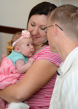 Baby Carlee is thriving thanks to specially trained nurses that detected heart disease in the newborn.