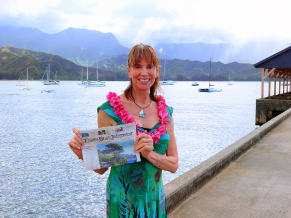 Local Pamela Horton visited Kauai to see friends and celebrate a  birthday. She took her local paper to Hanalei, is a favorite spot on the island. She also glided along the Wailua River, the only fresh water skiing in Hawaii.