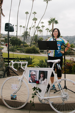 Joan Marcus-Colvin addresses cyclists assembled in Heisler Park last year before the memorial ride in honor of her husband.