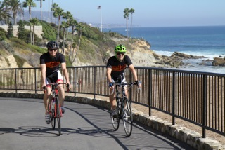 Local bike enthusiast Max Isles and friend Ryan O'Malley pedal through Heisler Park before setting out on a fundraising trek next week.