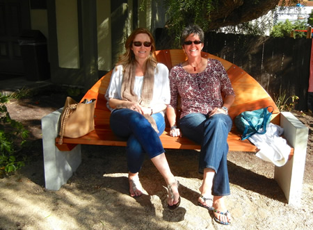 : Carrie Pohlhammer and Vicky Wilson enjoying one of Brantlee Griffith's two benches, which were installed in January.