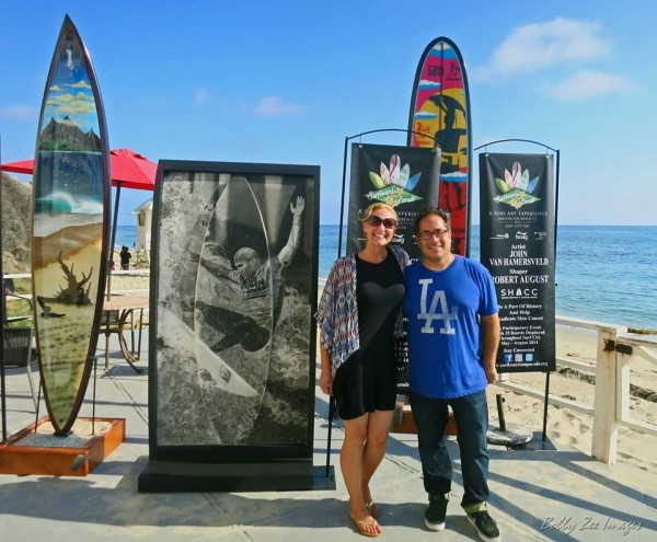 Dave Hobrecht and his fiancée Carly Squires with the artist's Kelly Slater-inspired board. Photo courtesy of Bobby Z.