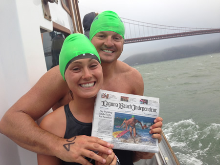 Tom and Faith Hale shiver under San Francisco's Golden Gate Bridge before making a six mile swim.Photo courtesy of tom Hale.