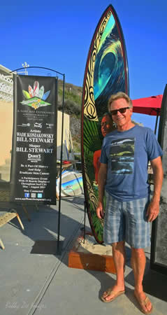Artist Wade Koniakowsky with the Polynesian theme board he created with well-known shaper Bill Stewart .