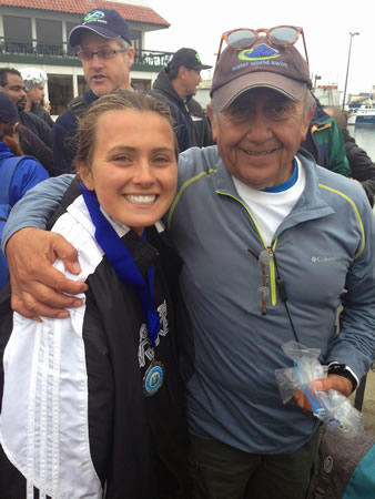 Faith Hale with open-water trainer Pedro Ordenes, the race organizer.
