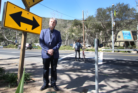 College President Jonathan Burke near a campus crosswalk where a new signal will be installed. Photo by Jody Tiongco.