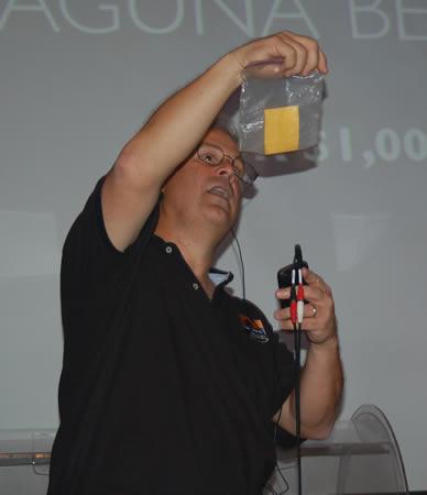 Ocean Institute board member Bill Steel draws 2013's grand prize winner.