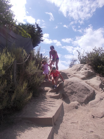 Lori Mitsuka and her daughters, Alice and Sanae, on the unimproved public path in the old Top of the World neighborhood in 2012.