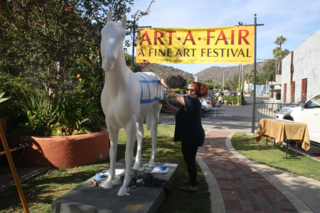 An equine sculpture is readied for artists, who will paint squares of a faux blanket as a benefit for a horse sanctuary.