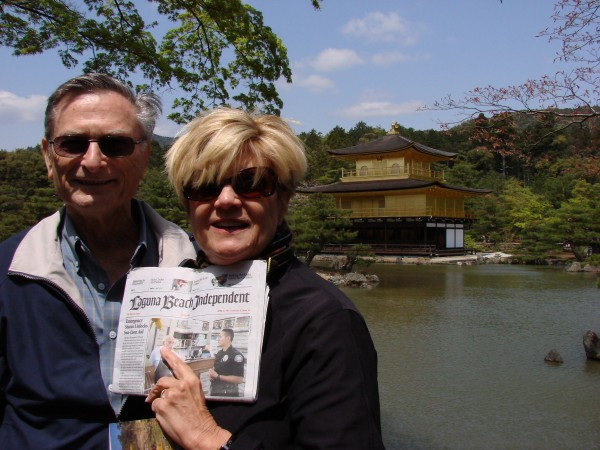 Locals Bob and Pam Feldman outside Kyoto's Golden Pavilion. The Laguna Beach couple lead tours around the world. Their next stops: Russia and South Africa.