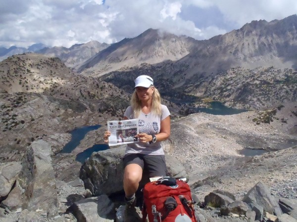 Marsha Bianchi carried the Laguna Beach Independent on a five-day backpacking trip on the Rae Lakes Loop Trail, a portion of the John Muir Trail, into the back country of spectacular Kings Canyon National Park. She took this image at the highest point, 11,978-foot Glen Pass, during last year's Labor Day weekend. Her ascent started at 5,035 feet.