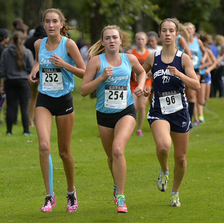Sophomore Kirsten Landsiedel and senior Natalie Kimball lead the pack at the 49th annual Lucky Lindy Invitational in Little Falls Minn. on Thursday, Sept. 11.Photo by Kimm Anderson courtesy of St. Cloud Times