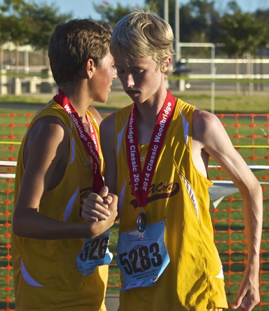 Luc La Montagne and Dylan Miller congratulate each other after their third place victory in the division IV frosh race at the Woodbridge Invitational. Photo by Holly Miller.