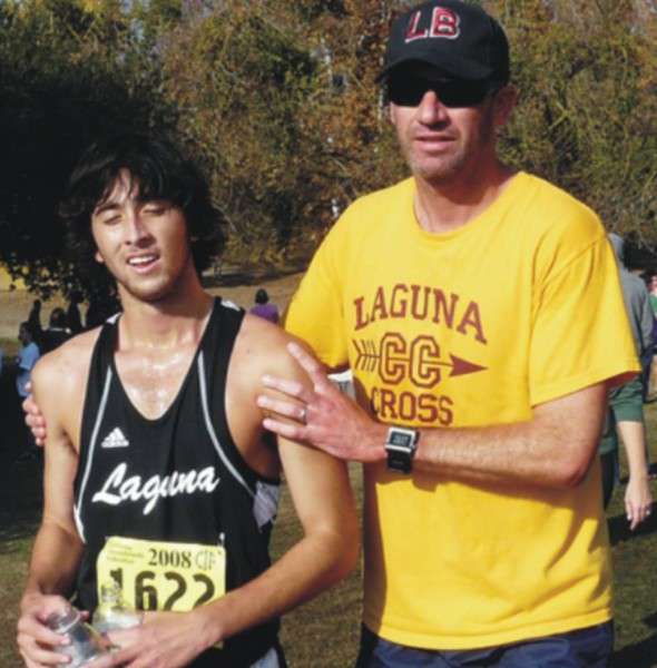 Coach Dave Brobeck consoles Casey Finnerty after Laguna's eighth place finish at State finals in 2008.