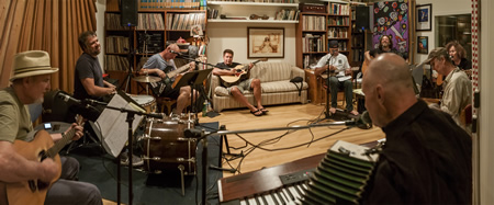 Members of 133 practice for their opening act; from left, Poul Pedersen, Drew Hester, Alan Deremo, Clay Berryhill, Nick Hernandez, Jason Feddy, Beth Wood, Bob Hawkins and Steve Wood. Photo by Mitch Ridder.