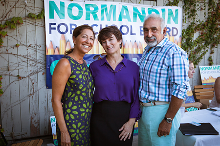 Carol Normandin, center, with supporters Suzy and Jeff Elghanayan, a former school board candidate. Photo by Jon Barber.
