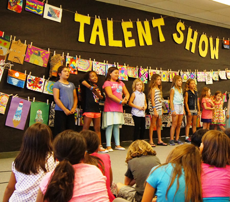 Club members try out their performing skills in a talent show.