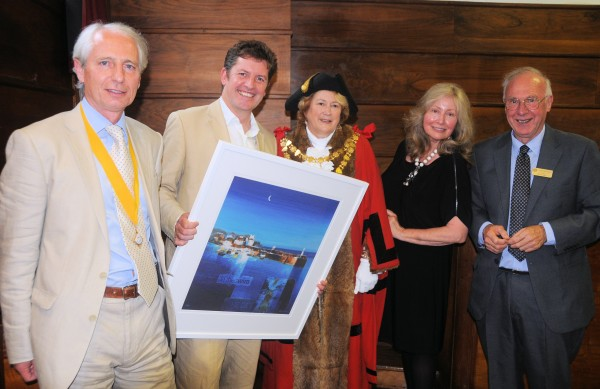 Mayor of St. Ives, Linda Taylor, center, as artist Glyn Macey, second from left, presents Laguna's Karyn Philippsen, second from right, with a St. Ives scene. With them is Steven Taylor, far left, and Ron Tulley, far right.