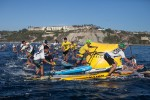 Racers Brave Big Surf in Paddling Contest