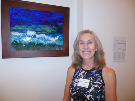 Jill Cooper with her work at the Susi Q gallery.