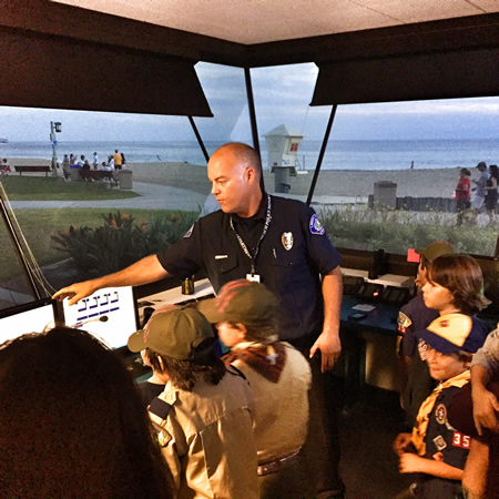 Lifeguard Capt. Tom Trager shows visitors what's behind the black-out windows.