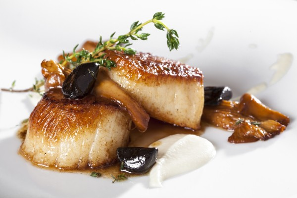 Despite its name, Selanne Steak Tavern also serves fish, such as roasted scallops.
