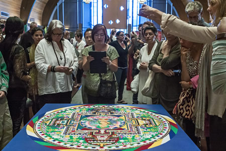 Neighborhood Congregational Church parishioners and visitors view and photograph the finished sand mandala