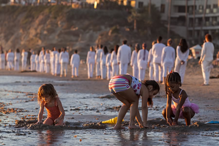 Not even Lita Albuquerque's unusual procession last November could distract these beach-goers. Photo by Mitch Ridder.
