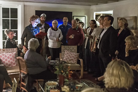Incumbent Toni Iseman checks election results with supporters at her home on election night. Photo by Mitch Ridder